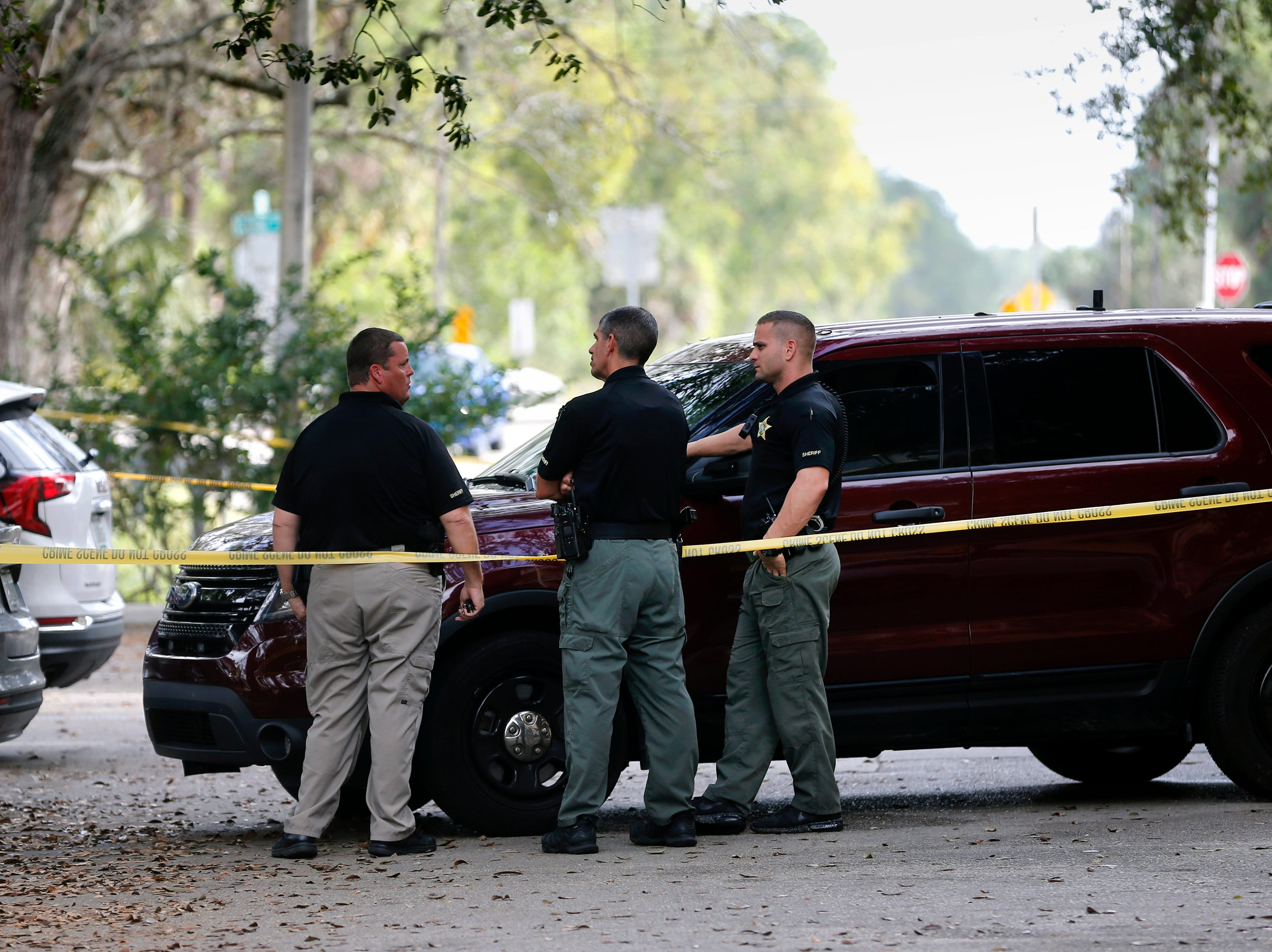 Collier County Sheriff's Office deputies cordon off an area where a homicide occurred, Thursday morning, Jan. 3, 2019, at a condominium complex in the 4000 block of Golden Gate Parkway near Collier Boulevard.