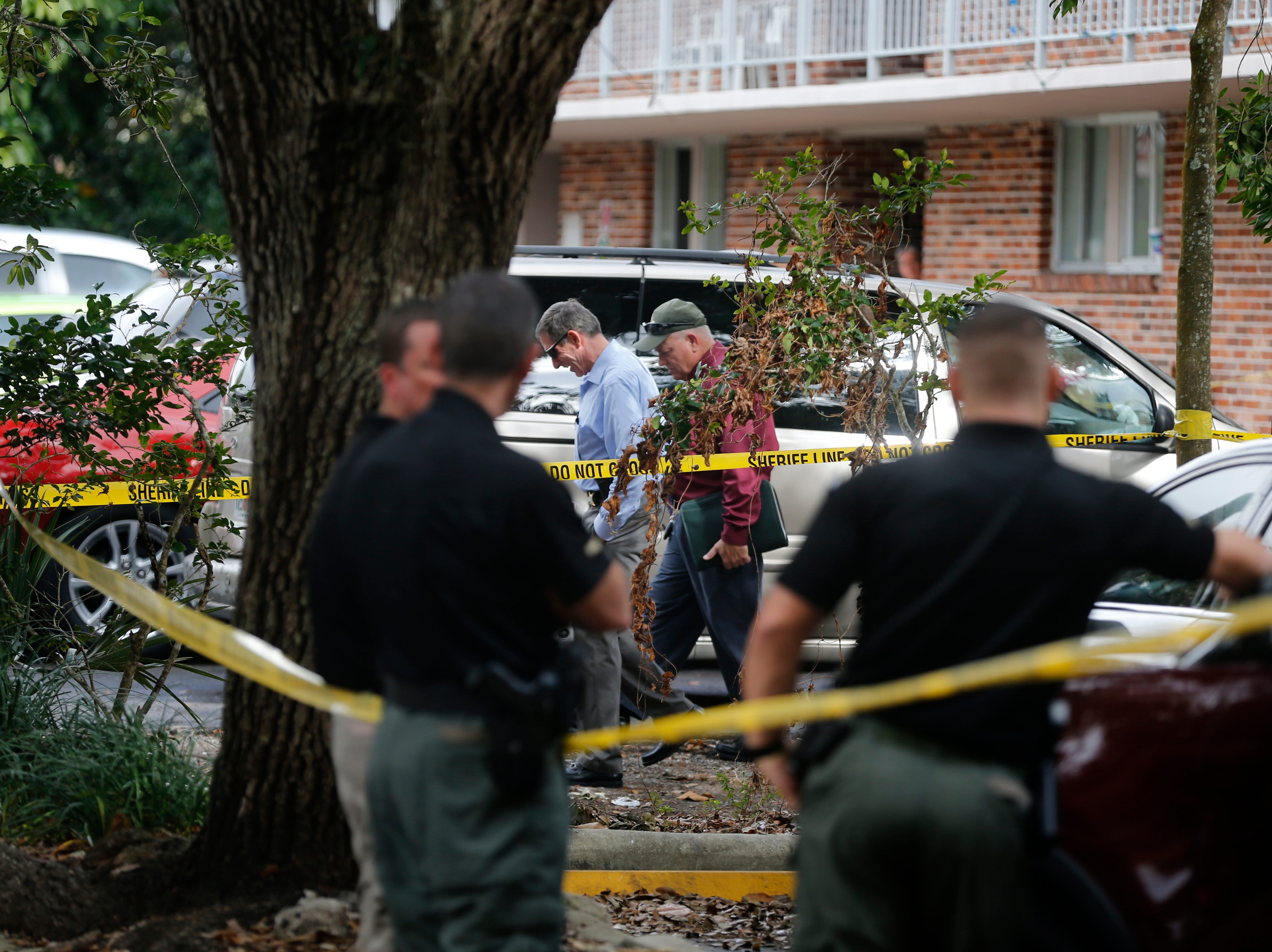 Detectives with the Collier County Sheriff's Office investigate the scene of a homicide, Thursday, Jan. 3, 2019 at a condominium complex in the 4000 block of Golden Gate Parkway near Collier Boulevard.