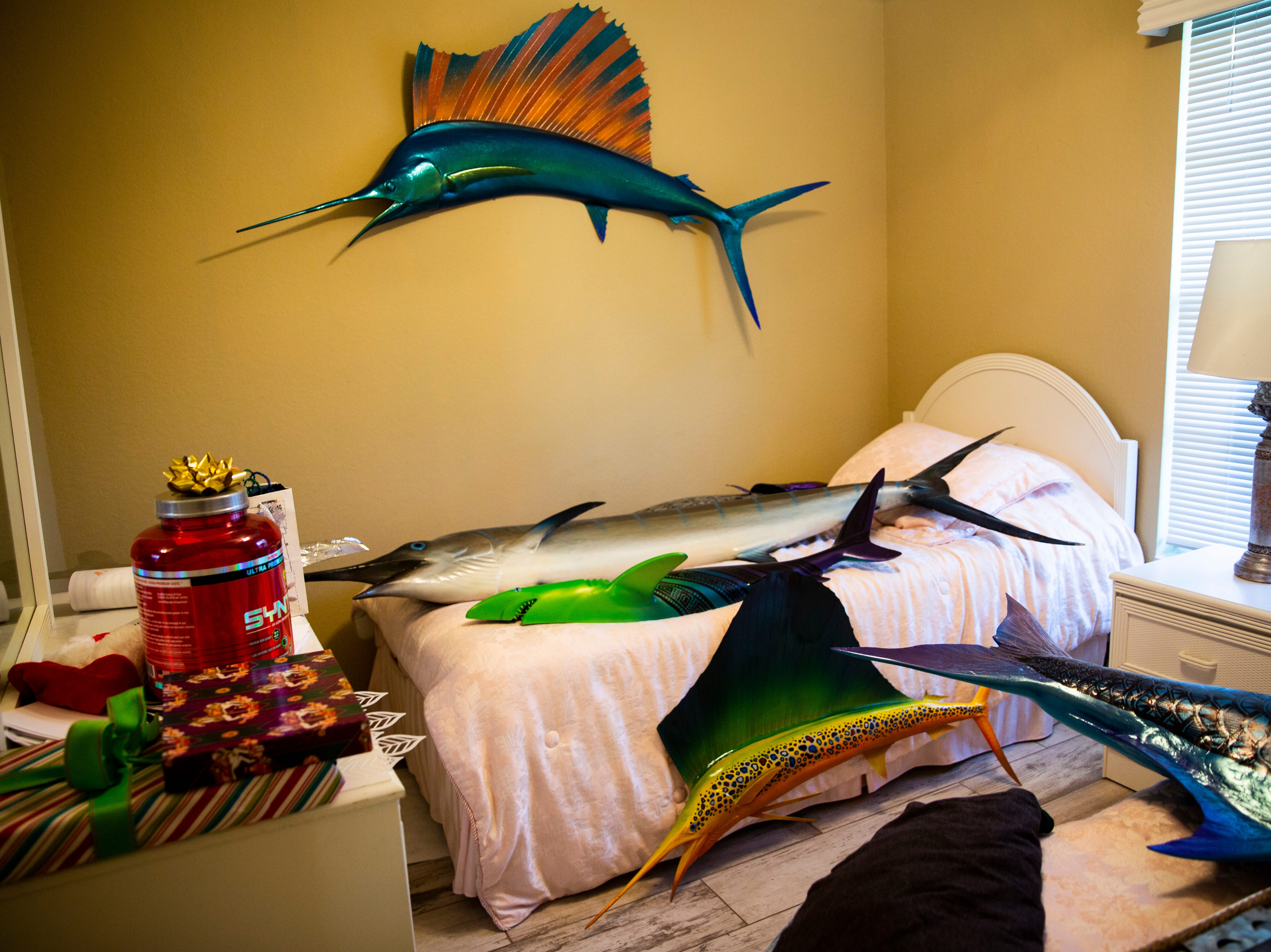 Fiberglass fish lie all around the bedroom where Jake Jones' daughters sleep when they come to visit on Wednesday, Jan. 2, 2019, at his home in Golden Gate Estates.
