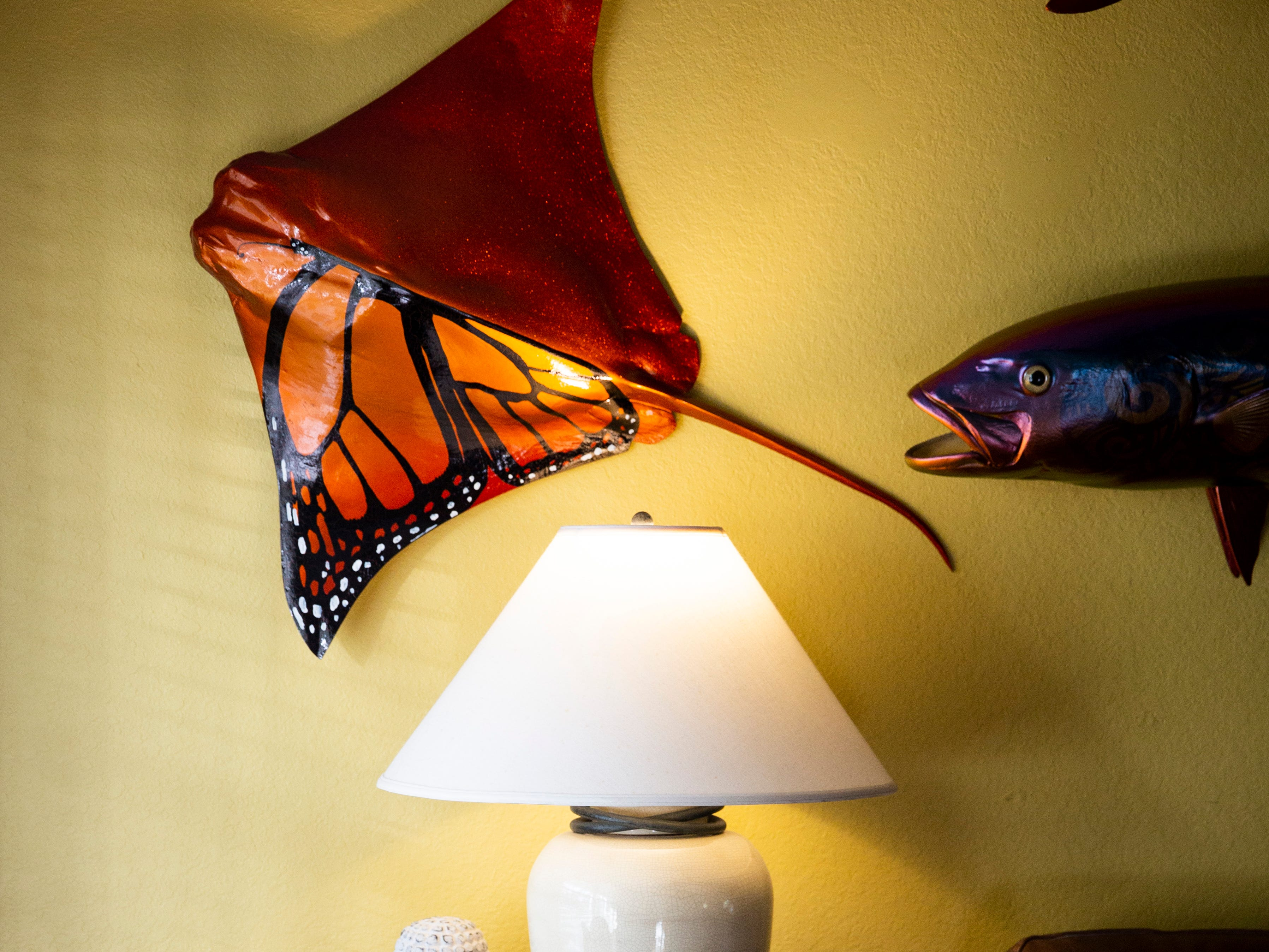Jake Jones' artwork sits on display in his living room on Wednesday, Jan. 2, 2019, at his home in Golden Gate Estates. Jones said he always wanted to paint a stingray as a butterfly, and he was happy with the results.