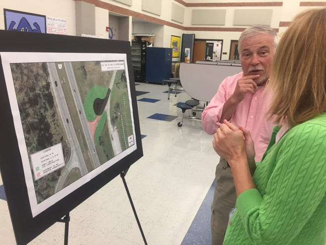 Granville Township Trustee Kevin Bennett discusses the Ohio 37 bridge widening with ODOT's Julie Gwinn during a public forum last September.