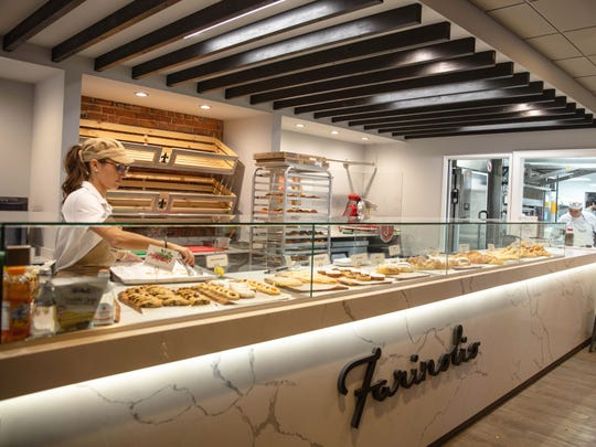 A large counter displays the baked goods at Farinolio.