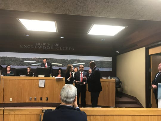 Assemblyman Gordon Johnson swears in Councilwoman Gloria Oh as Englewood Cliffs council president on Jan. 3, 2019.