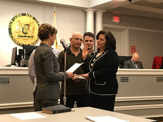 Gail Rottenstrich, joined by her family, is sworn in as deputy mayor of Fair Lawn by Assemblywoman Lisa Swain, D-Bergen, on Wednesday, Jan. 2, 2019.