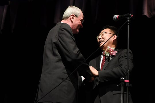 Christopher Chung is congratulated by Governor Phil Murphy after being sworn in as mayor at Palisades Park Junior/Senior High School on Wednesday, January 2, 2019. Chung is the first Korean-American mayor of Palisades Park.