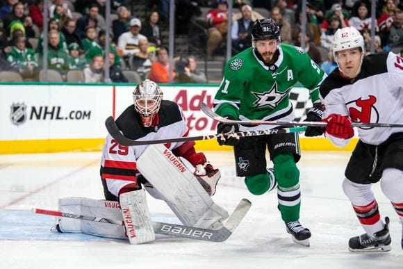 Dallas Stars center Tyler Seguin (91) and New Jersey Devils goaltender Mackenzie Blackwood (29) look for the puck during the second period at the American Airlines Center.