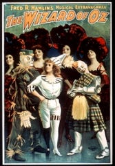 """The Wizard of Oz"" -- the 1902 stage show. Who knows why the Scarecrow and the Tin Man are in Scottish clothes?"