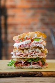 The sandwiches at Farinolio are stacked with imported meats and cheeses.