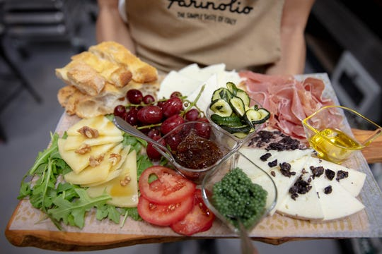 Charcuterie boards with spreads, oils, meats and cheeses are available at Farinolio.