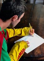 Adventureman Jamie McDonald pens his letter.