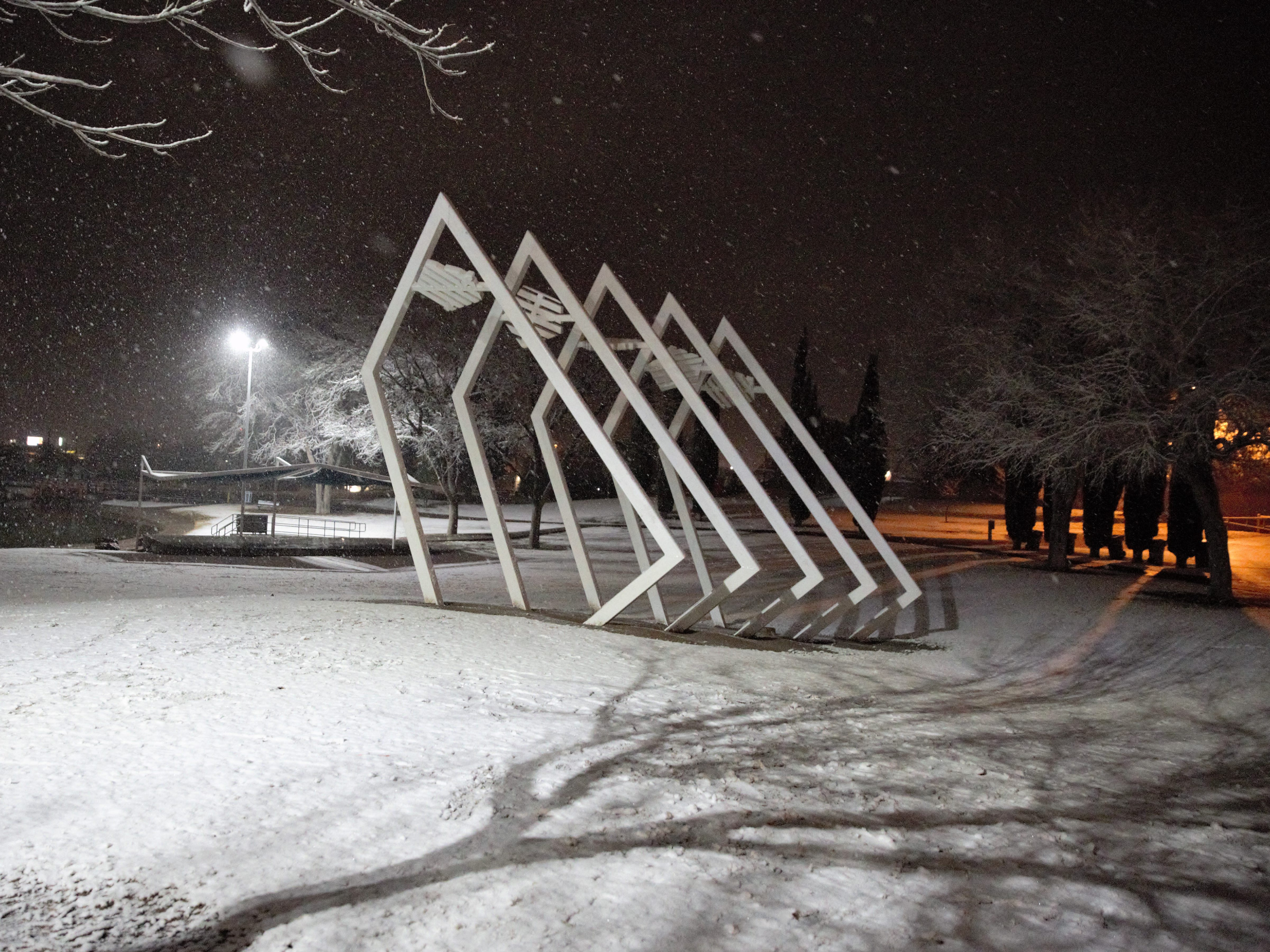 A sculpture stands at Young Park on a snowy night Wednesday, Jan. 2, 2019.