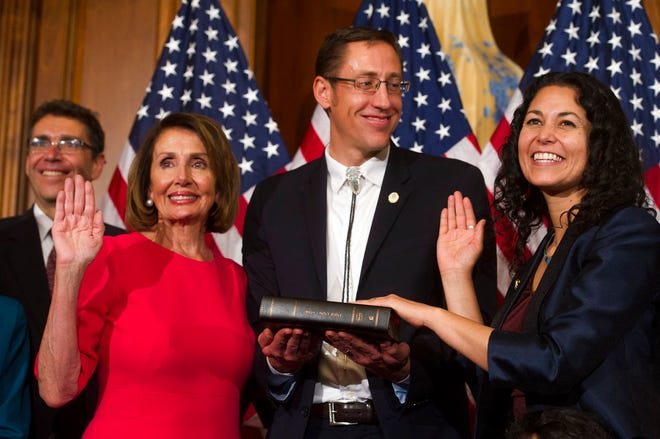 House Speaker Nancy Pelosi of Calif., right, poses during a ceremonial swearing-in with Rep. Xochitl Torres Small, D-N.M., on Capitol Hill in Washington, Thursday, Jan. 3, 2019, during the opening session of the 116th Congress. Washington, Thursday, Jan. 3, 2019. (AP Photo/Cliff Owen)