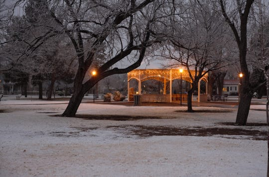 A passing storm dropped a dusting of snow on Las Cruces on Wednesday, Jan. 2, 2019, creating wintry scenes like this one at Pioneer Women's Park in the heart of the city.