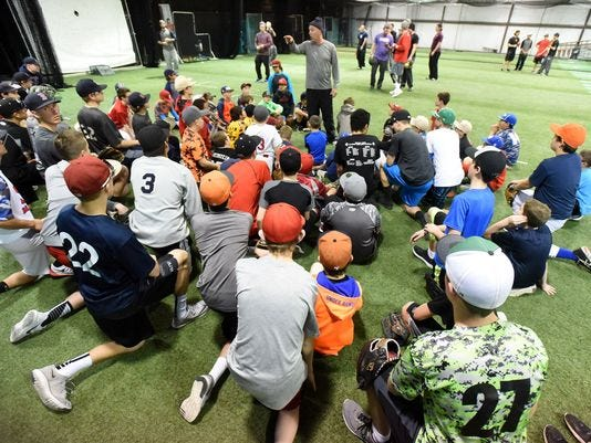 Albuquerque Baseball Academy's Ryan Brewer talks with a group of kids at the Grinders for Grace baseball camp on Jan. 9, 2016, at the Strike Zone training facility in Farmington.