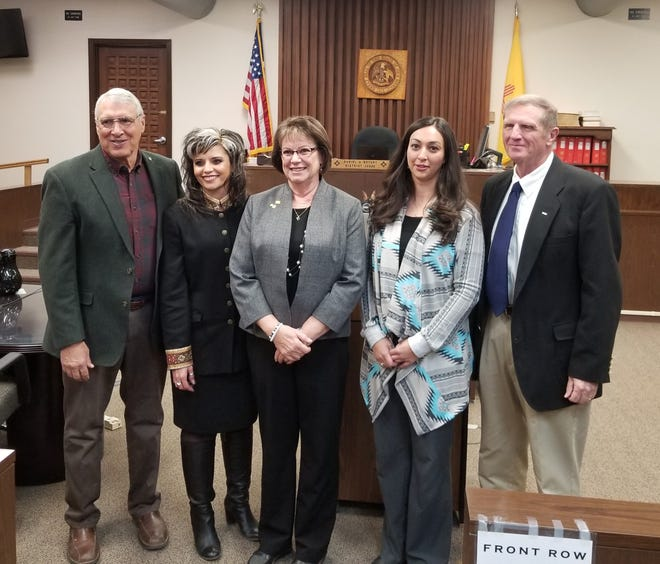 Taking their oaths of office Jan. 2, in Carrizozo were from left County Commissioner Lynn Willard, Division 1 Magistrate Judge Mickie Vegas, County Treasurer Beverly Calaway, County Whitney Whittaker and Commissioners Tom Stewart.