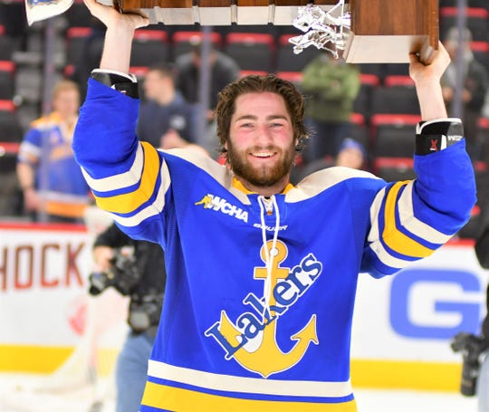 Max Humitz hoisted the Great Lakes Invitational trophy just a day before his father Mike passed away at age 54.