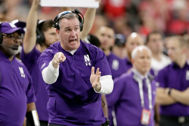 Northwestern head coach Pat Fitzgerald watches from the sidelines during the second half of the Big Ten championship NCAA college football game against Ohio State, Saturday, Dec. 1, 2018, in Indianapolis. (AP Photo/Michael Conroy)