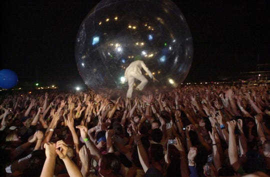 Wayne Coyne of the Flaming Lips surfs the crowd inside a bubble at the 2004 Coachella.