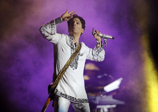 Prince performs during his headlining set on the second day of the Coachella Valley Music and Arts Festival in Indio, Calif., Saturday, April 26, 2008.