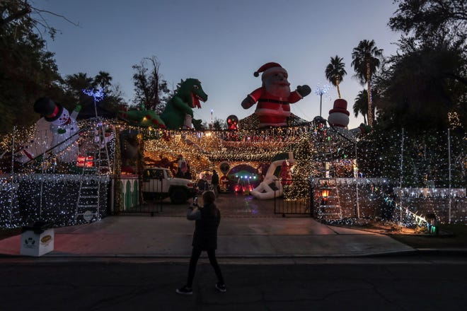 Visitors tour Robolights on its last night on Wednesday, January 2, 2019 in Palm Springs