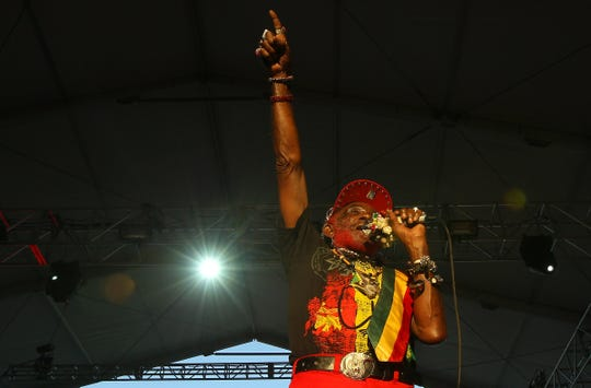 Lee Scratch Perry performs at the Coachella Festival in 2013.