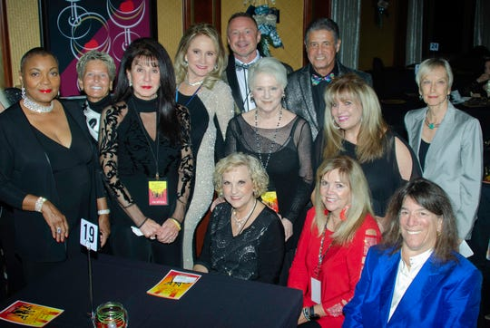 The Desert Jam committee gathers for an informal portrait. Front row, from left: Violet Kane, Pam Rogers, the Well's President Arlene Rosenthal. Back row, from left: Ace Whittecar, Kathryn White, Angela Glatfelter, Event Chair Darci Daniels, Tom Kuhn, Michael D'Angelo, Nancy Rosenthal, Patty D'Angelo, Anita Roark