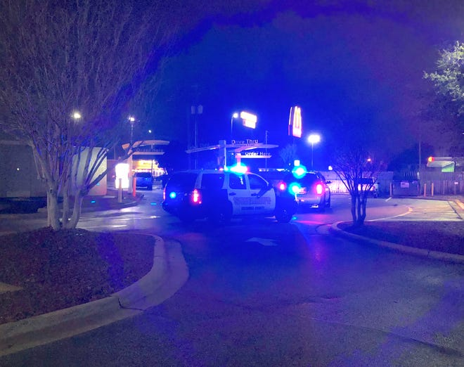 Escambia County Sheriff's Office deputies on Wednesday, Jan. 2, 2018, investigate after a person allegedly pulled out a gun during an argument outside a McDonald's on North Navy Boulevard.