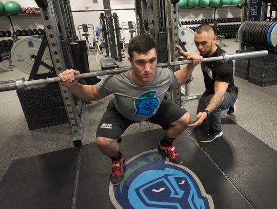 University of West Florida strength coach, Brandon Reyes, gives technical advice to Jacob Saulnier during his offseason workout at University of West Florida on Wednesday, Jan. 2, 2019.