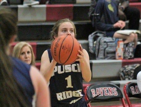 Ava Addleman of Pusch Ridge Christian Academy catches the ball.