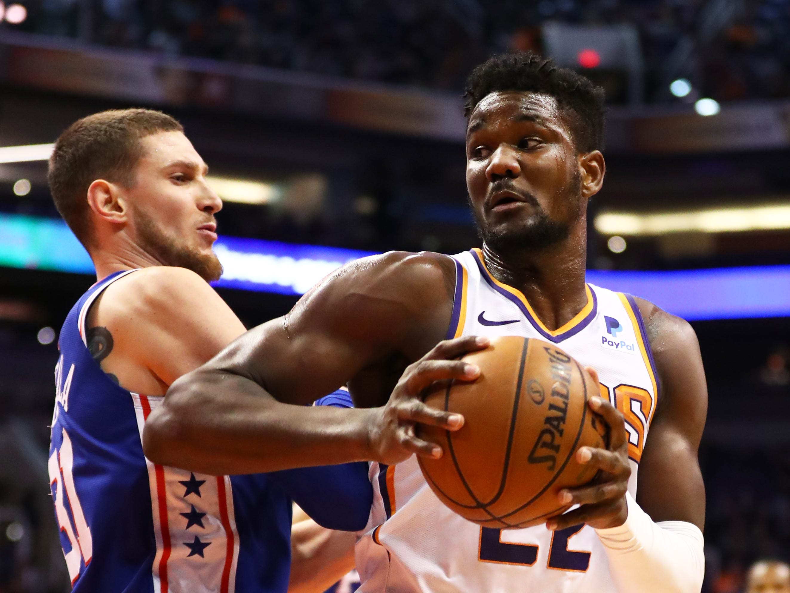 Jan 2, 2019; Phoenix, AZ, USA; Phoenix Suns center Deandre Ayton (right) against Philadelphia 76ers forward Mike Muscala in the first half at Talking Stick Resort Arena. Mandatory Credit: Mark J. Rebilas-USA TODAY Sports