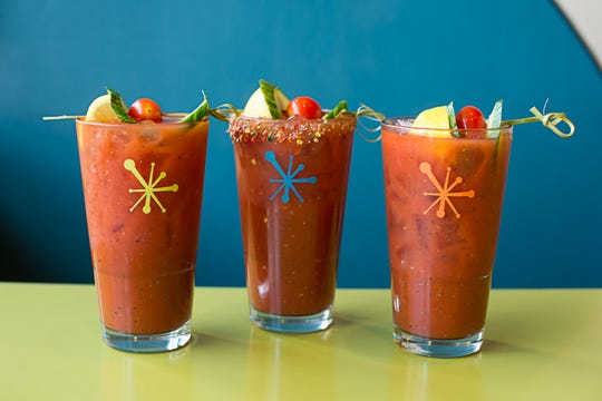 A lineup of bloody Marys at Snooze, an A.M. Eatery.