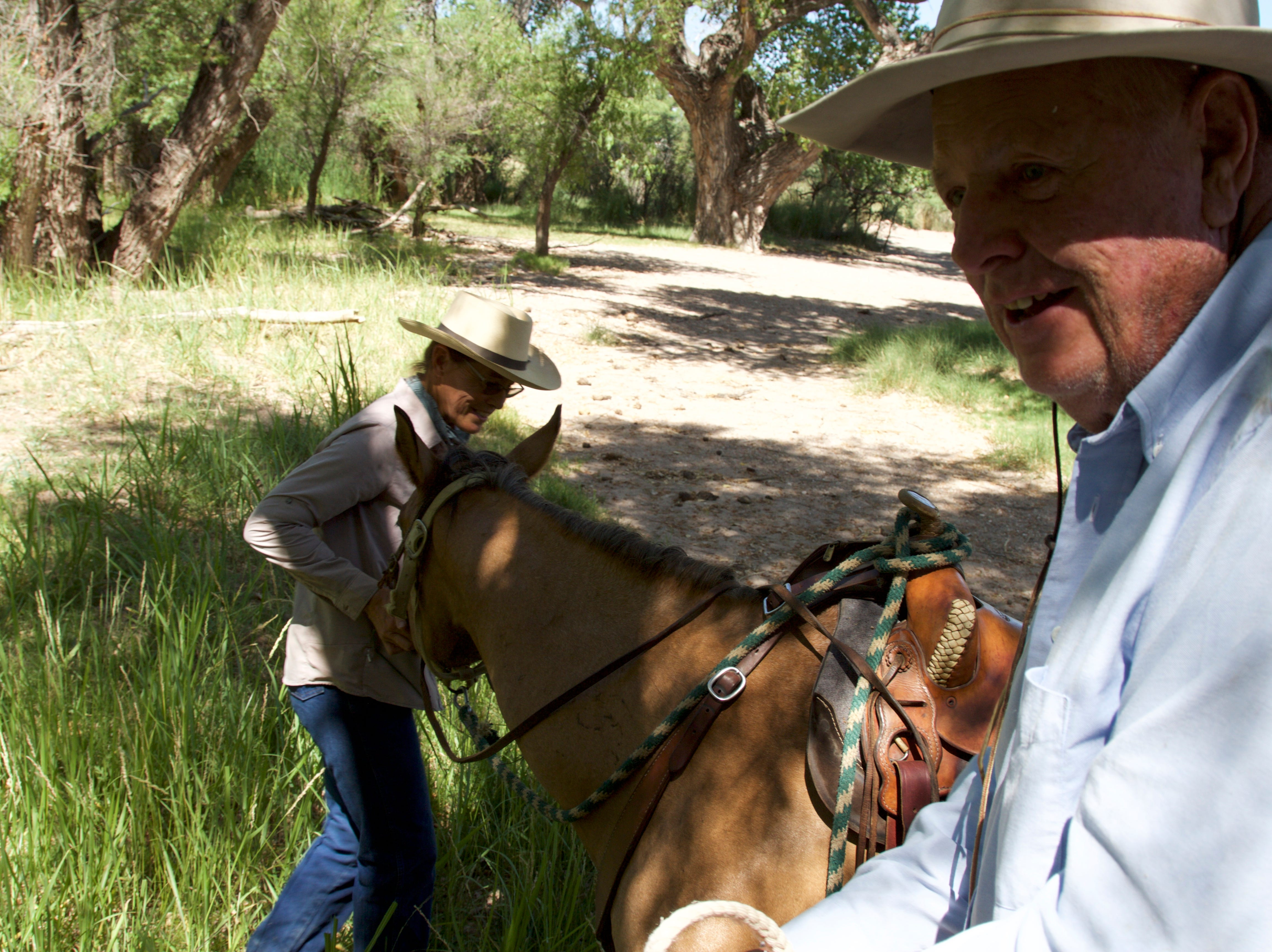 Mike Hayhurst and Holly Richter ride horses along the Babocomari River on June 23, 2018.