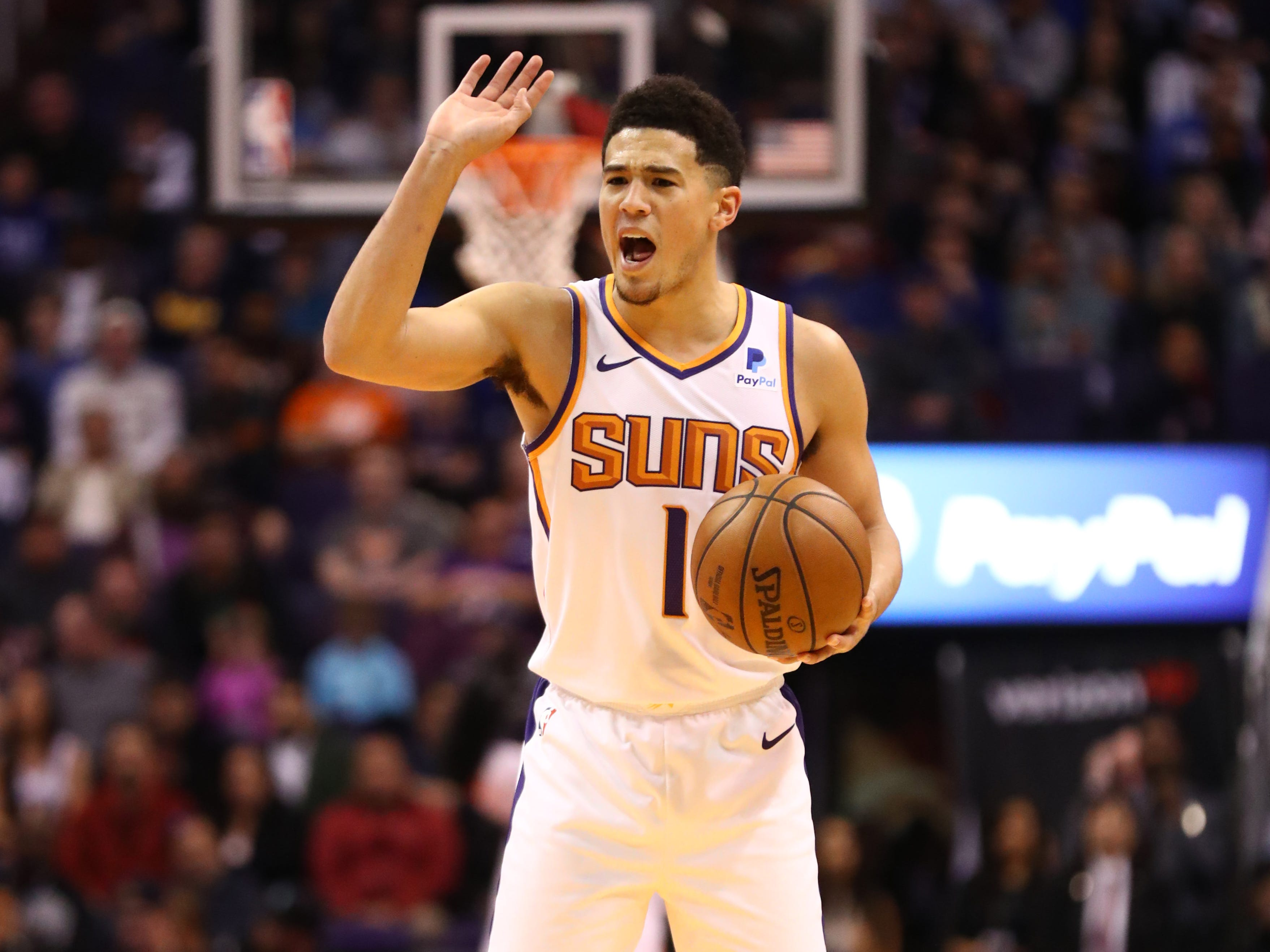 Jan 2, 2019; Phoenix, AZ, USA; Phoenix Suns guard Devin Booker (1) reacts against the Philadelphia 76ers in the first half at Talking Stick Resort Arena. Mandatory Credit: Mark J. Rebilas-USA TODAY Sports