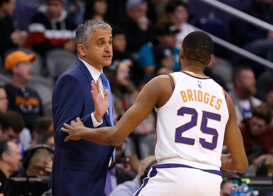 Suns coach Igor Kokoskov talks with rookie Mikal Bridges during the first half of a game Jan. 2 against the 76ers at Talking Stick Resort Arena.