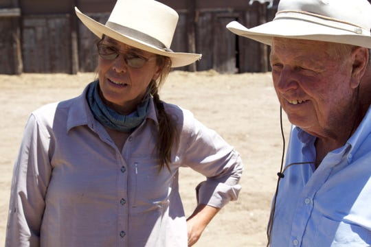 Holly Richter and Mike Hayhurst look at horses on Hayhurst's ranch on June 23, 2018.