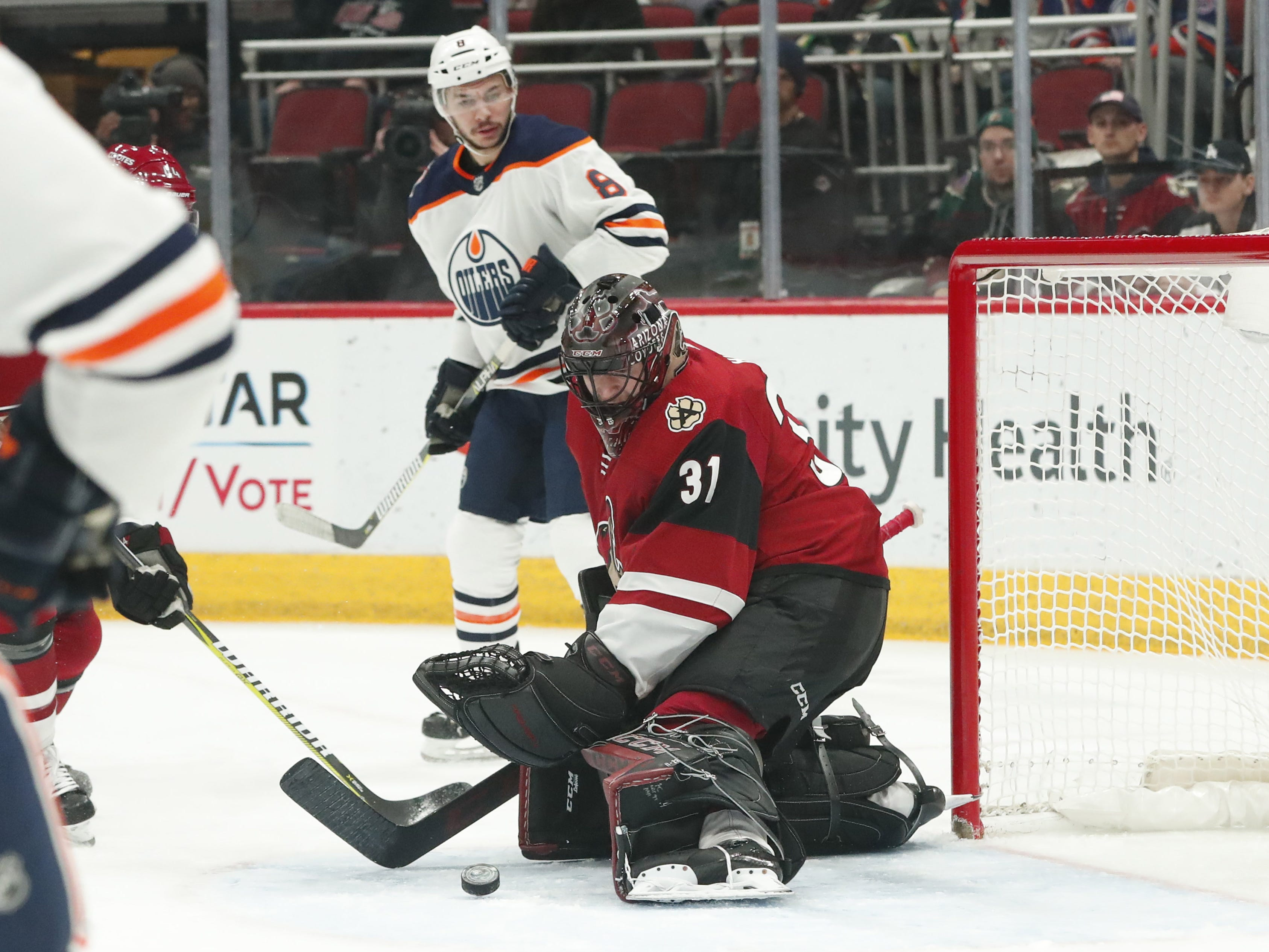 Arizona Coyotes goaltender Adin Hill (31) makes a save in front of Edmonton Oilers right wing Ty Rattie (8) during the first period in Glendale January 2, 2019.
