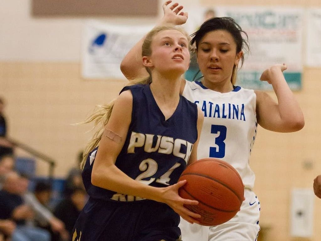 Angel Addleman of Pusch Ridge Christian Academy drives to the hoop.
