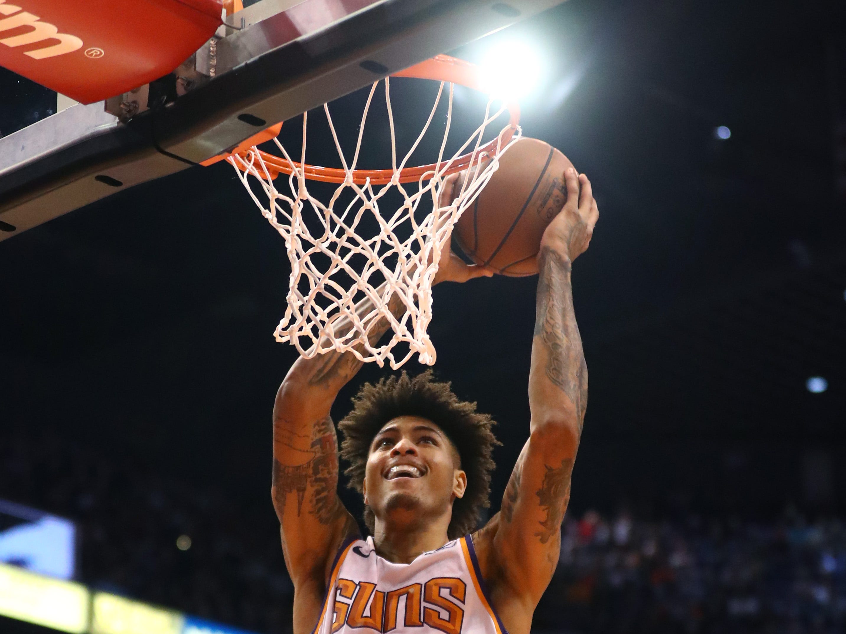 Jan 2, 2019; Phoenix, AZ, USA; Phoenix Suns forward Kelly Oubre Jr. (3) dunks the ball against the Philadelphia 76ers at Talking Stick Resort Arena. Mandatory Credit: Mark J. Rebilas-USA TODAY Sports