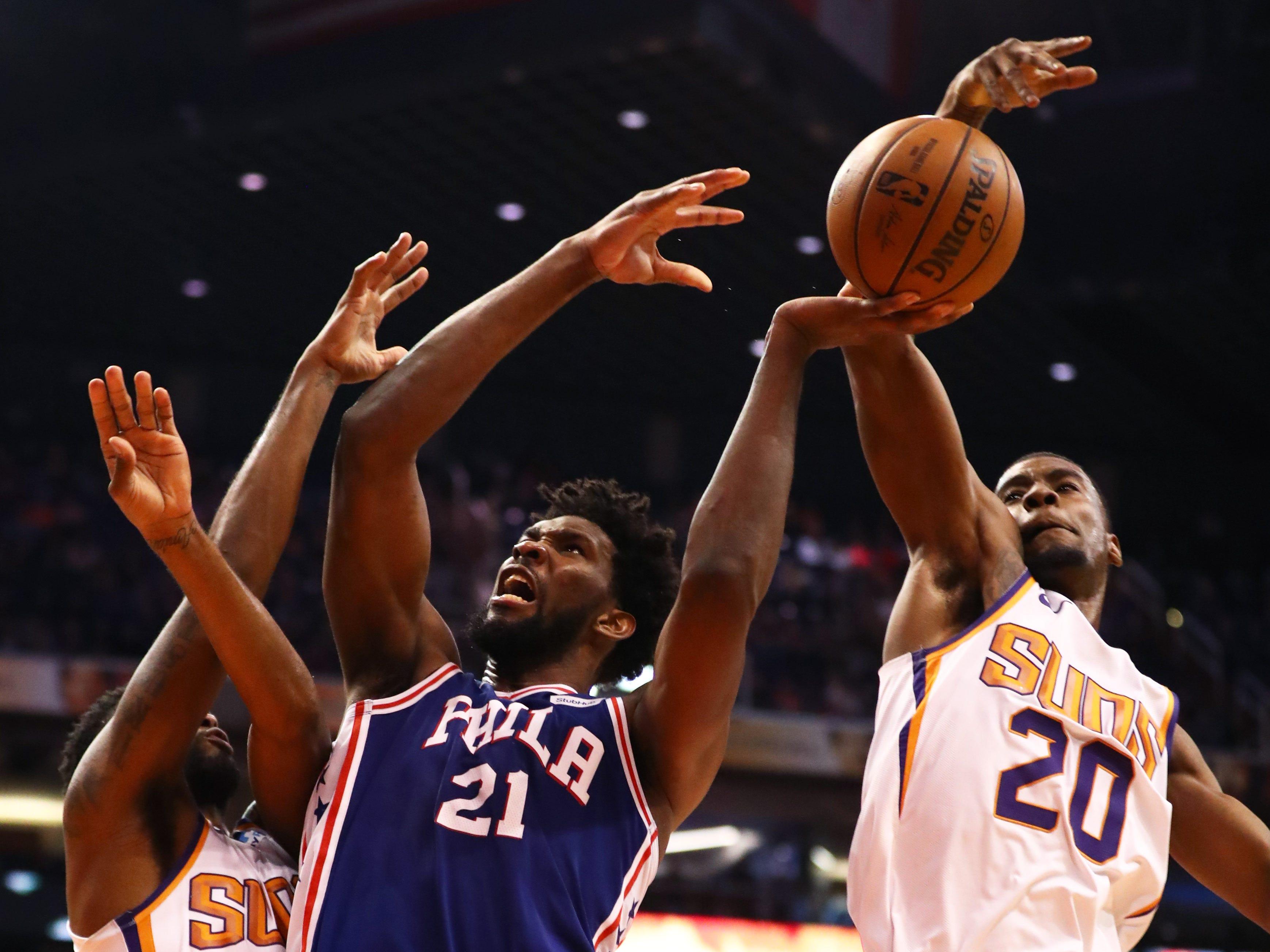 Jan 2, 2019; Phoenix, AZ, USA; Phoenix Suns forward Josh Jackson (20) blocks the shot of Philadelphia 76ers center Joel Embiid (21) in the second half at Talking Stick Resort Arena. Mandatory Credit: Mark J. Rebilas-USA TODAY Sports