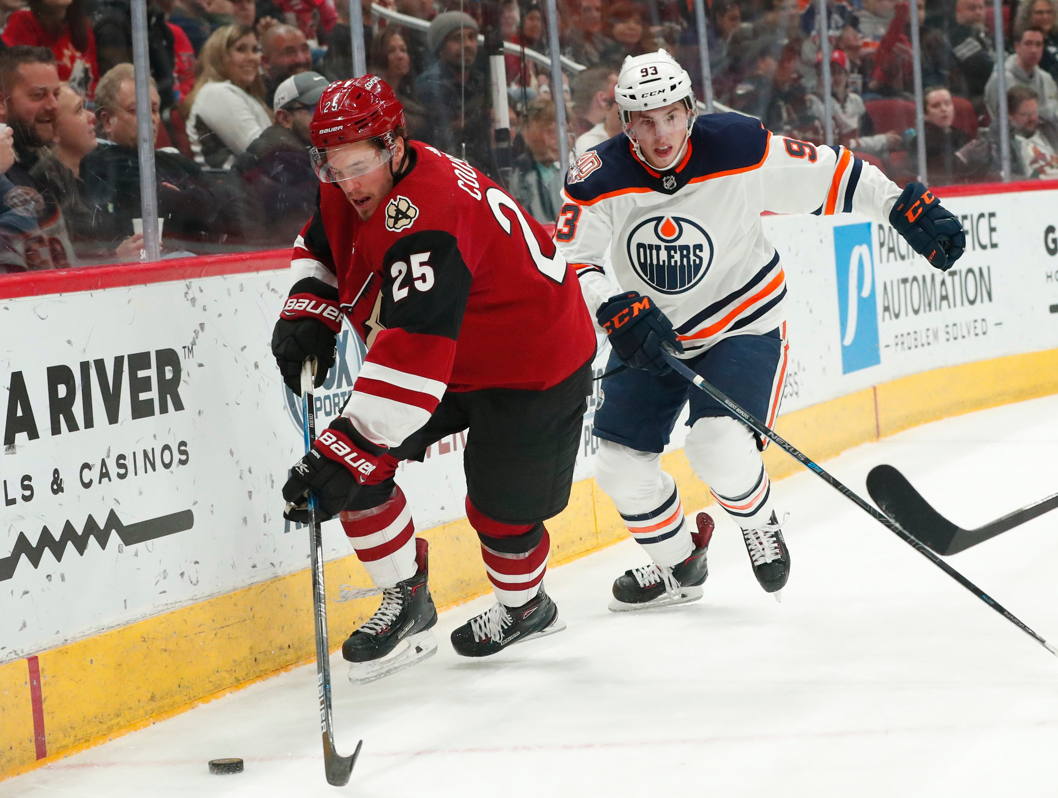 Arizona Coyotes center Nick Cousins (25) works the puck against Edmonton Oilers center Ryan Nugent-Hopkins (93) during the second period in Glendale January 2, 2019.