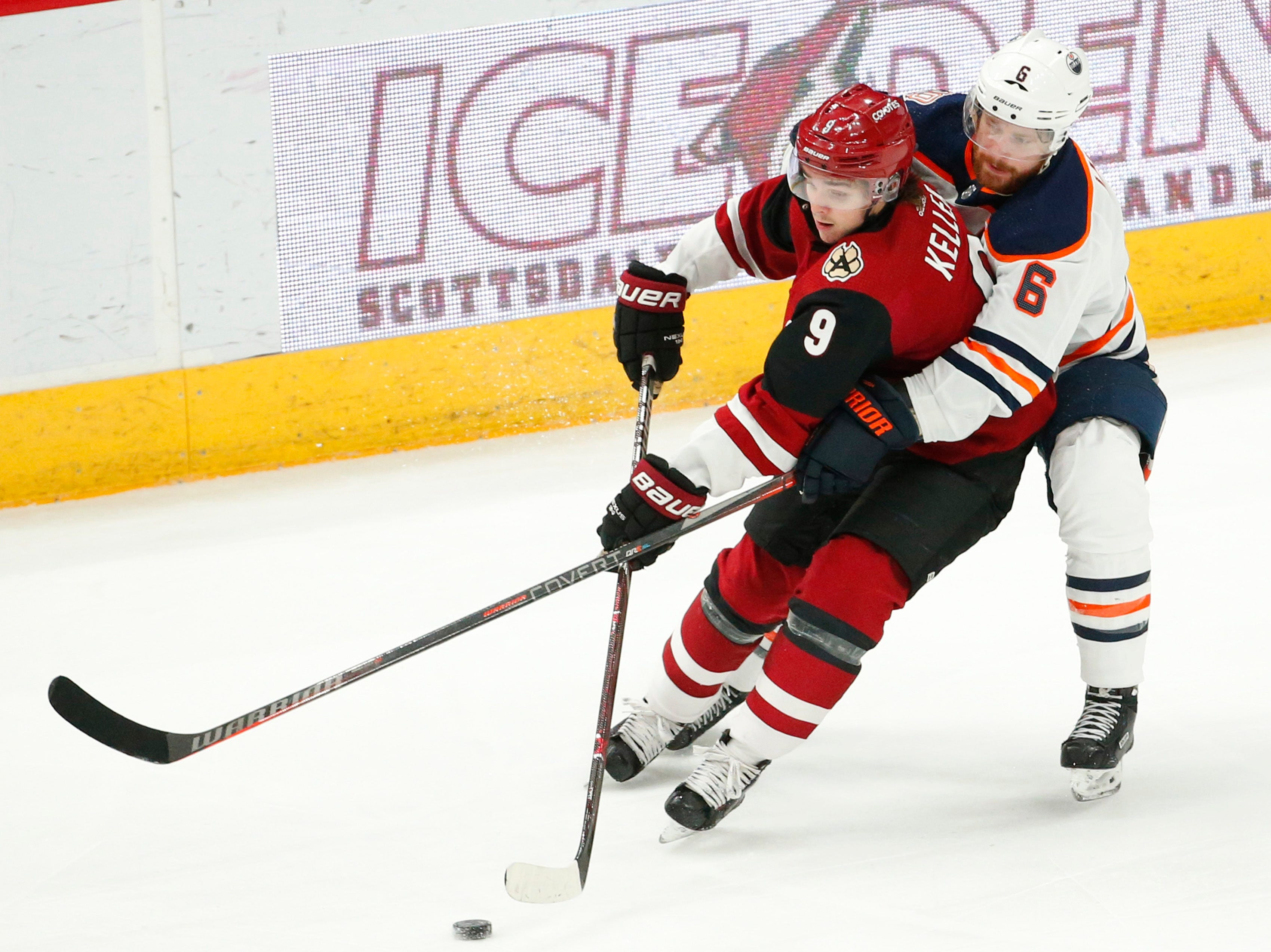 Arizona Coyotes center Clayton Keller (9) is defended by Edmonton Oilers defenseman Adam Larsson (6) during the third period in Glendale January 2, 2019.