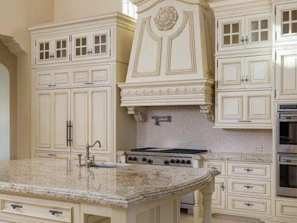 This Paradise Valley mansion, purchased by John Thomas Winterling, has a modern chef's kitchen and hand carved limestone and custom millwork.