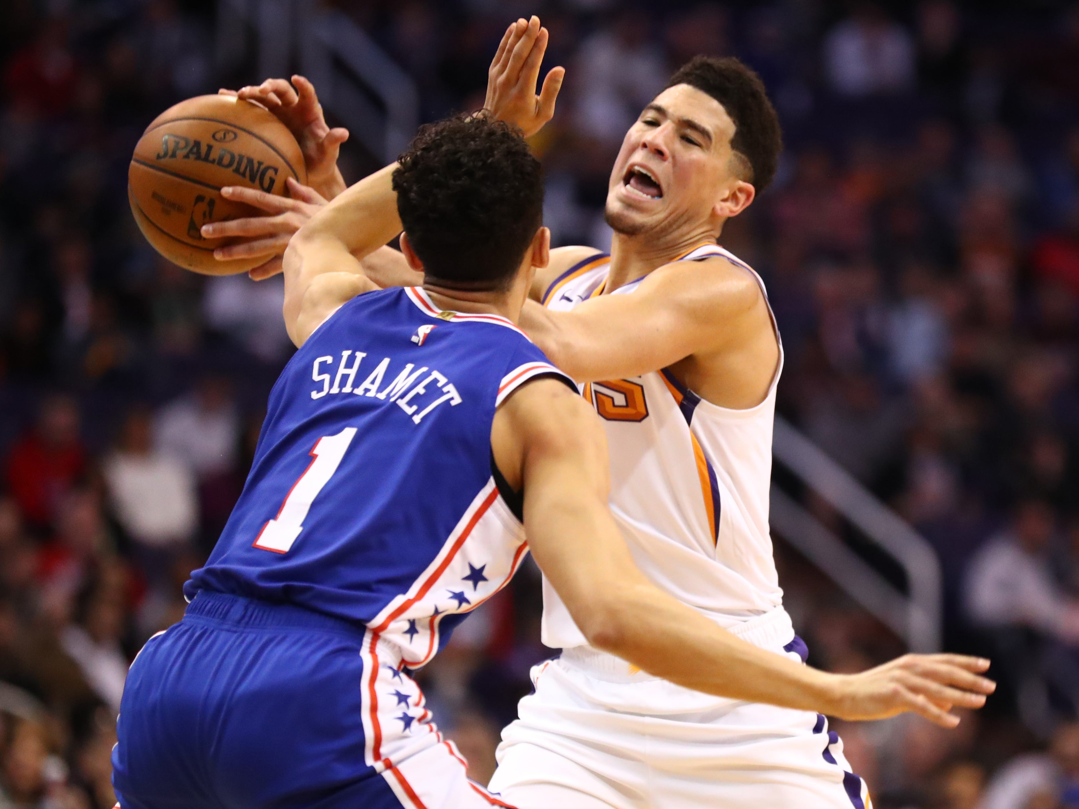 Jan 2, 2019; Phoenix, AZ, USA; Phoenix Suns guard Devin Booker (right) is fouled by Philadelphia 76ers guard Landry Shamet in the first half at Talking Stick Resort Arena. Mandatory Credit: Mark J. Rebilas-USA TODAY Sports
