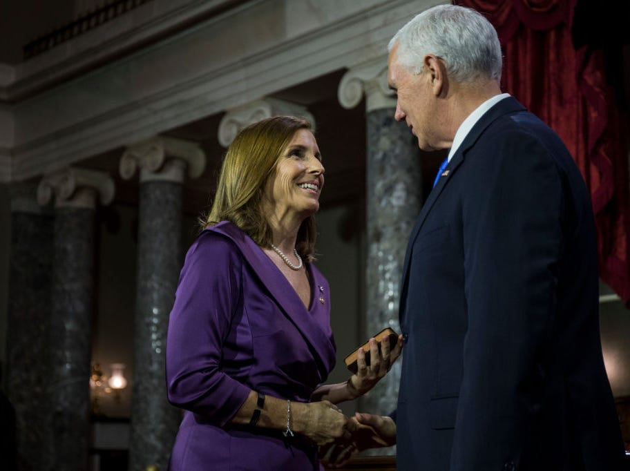Sen. Martha McSally shakes hands with Vice President Mike Pence during the swearing-in re-enactments for recently elected senators in the Old Senate Chamber on Capitol Hill in Washington, D.C., Jan. 3, 2019.