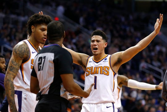 Suns guard Devin Booker reacts to a foul call during the first half of a game against the 76ers at Talking Stick Resort Arena.