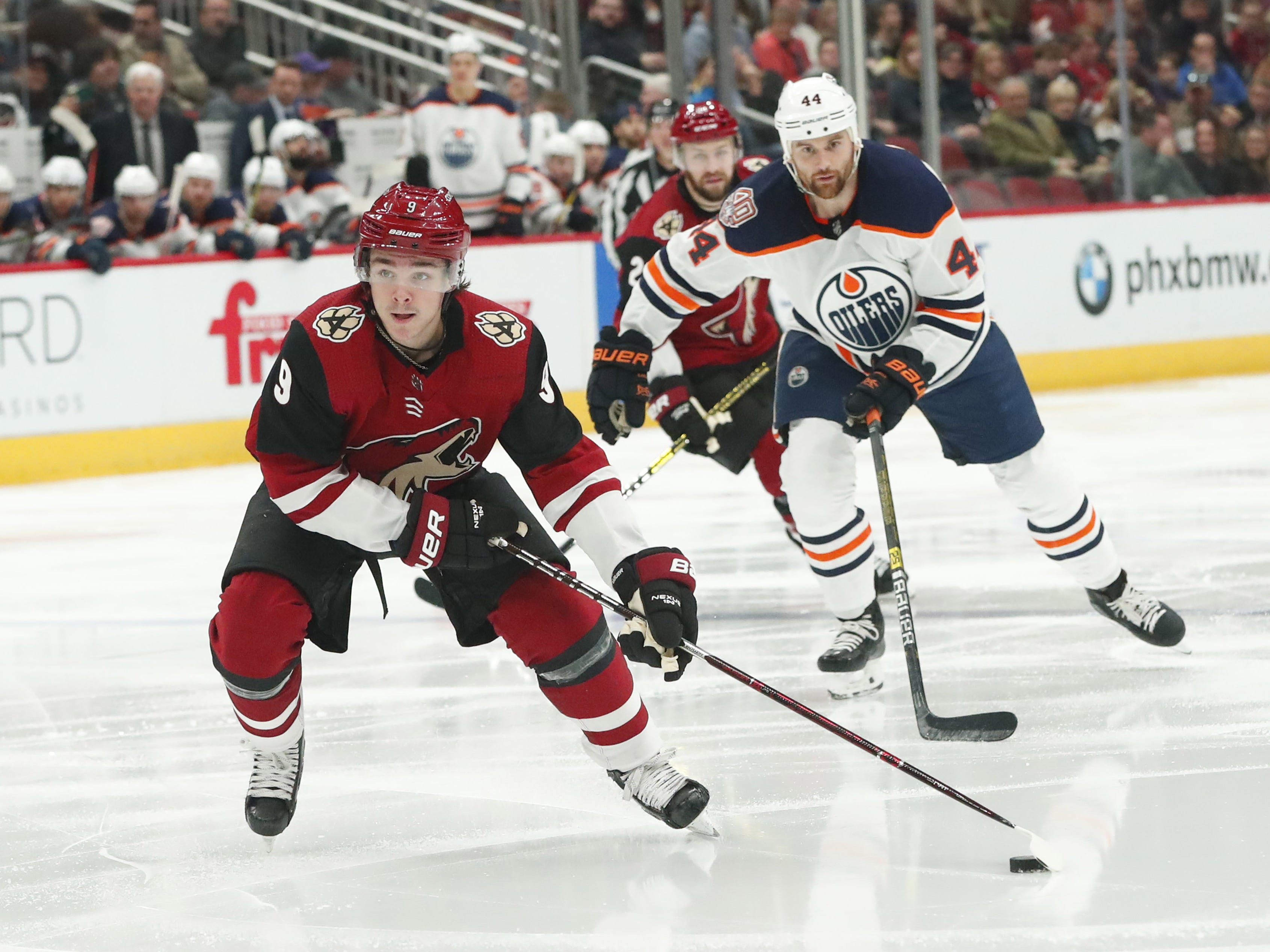 Arizona Coyotes center Clayton Keller (9) prepares to shoot while defended by Edmonton Oilers right wing Zack Kassian (44) during the second period in Glendale January 2, 2019.