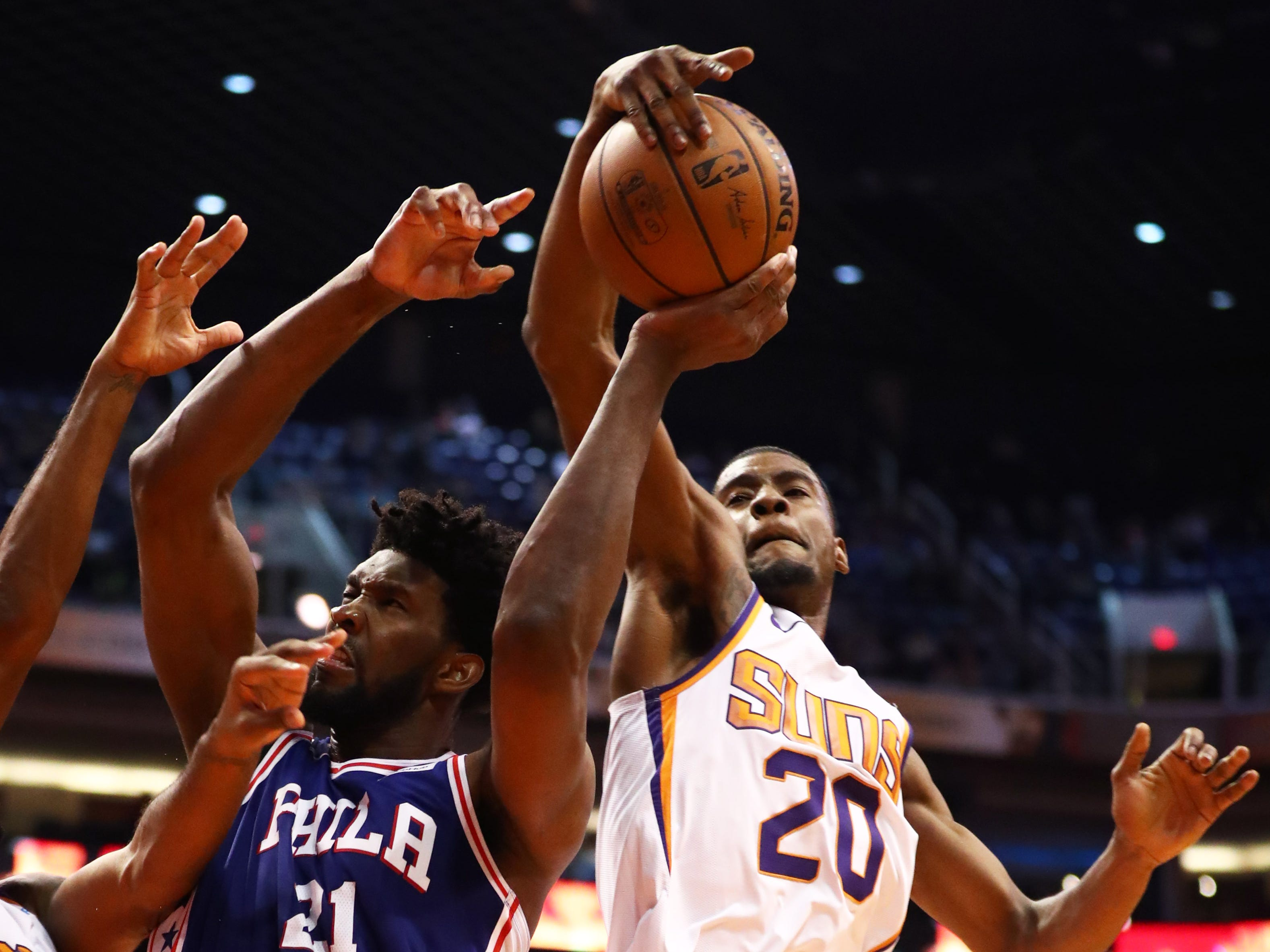 Jan 2, 2019; Phoenix, AZ, USA; Phoenix Suns forward Josh Jackson (20) blocks the shot of Philadelphia 76ers center Joel Embiid (21) in the second half at Talking Stick Resort Arena. Mandatory Credit: Mark J. Rebilas-USA TODAY Sports