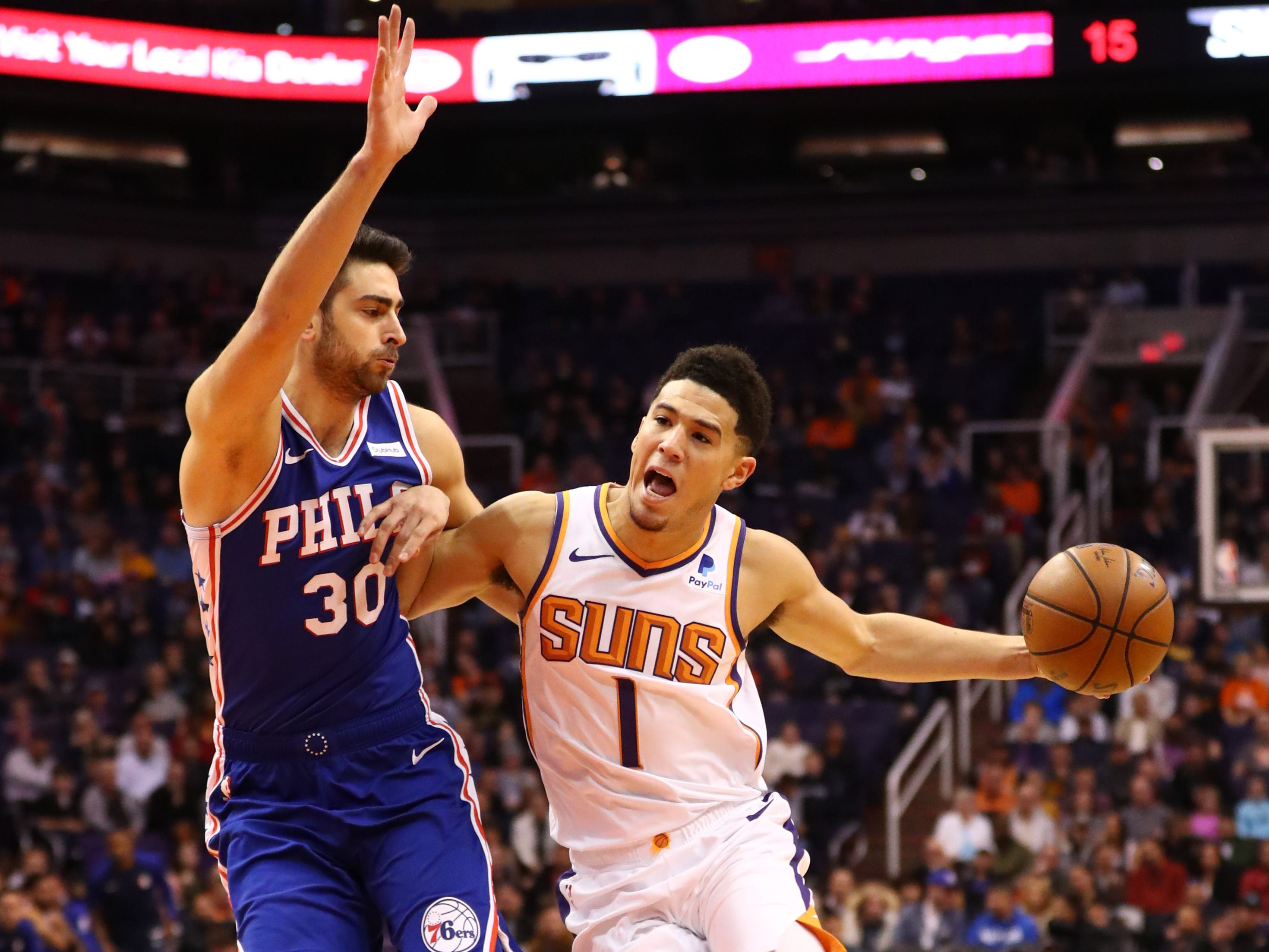 Jan 2, 2019; Phoenix, AZ, USA; Phoenix Suns guard Devin Booker (1) against Philadelphia 76ers guard Furkan Korkmaz (30) in the first half at Talking Stick Resort Arena. Mandatory Credit: Mark J. Rebilas-USA TODAY Sports