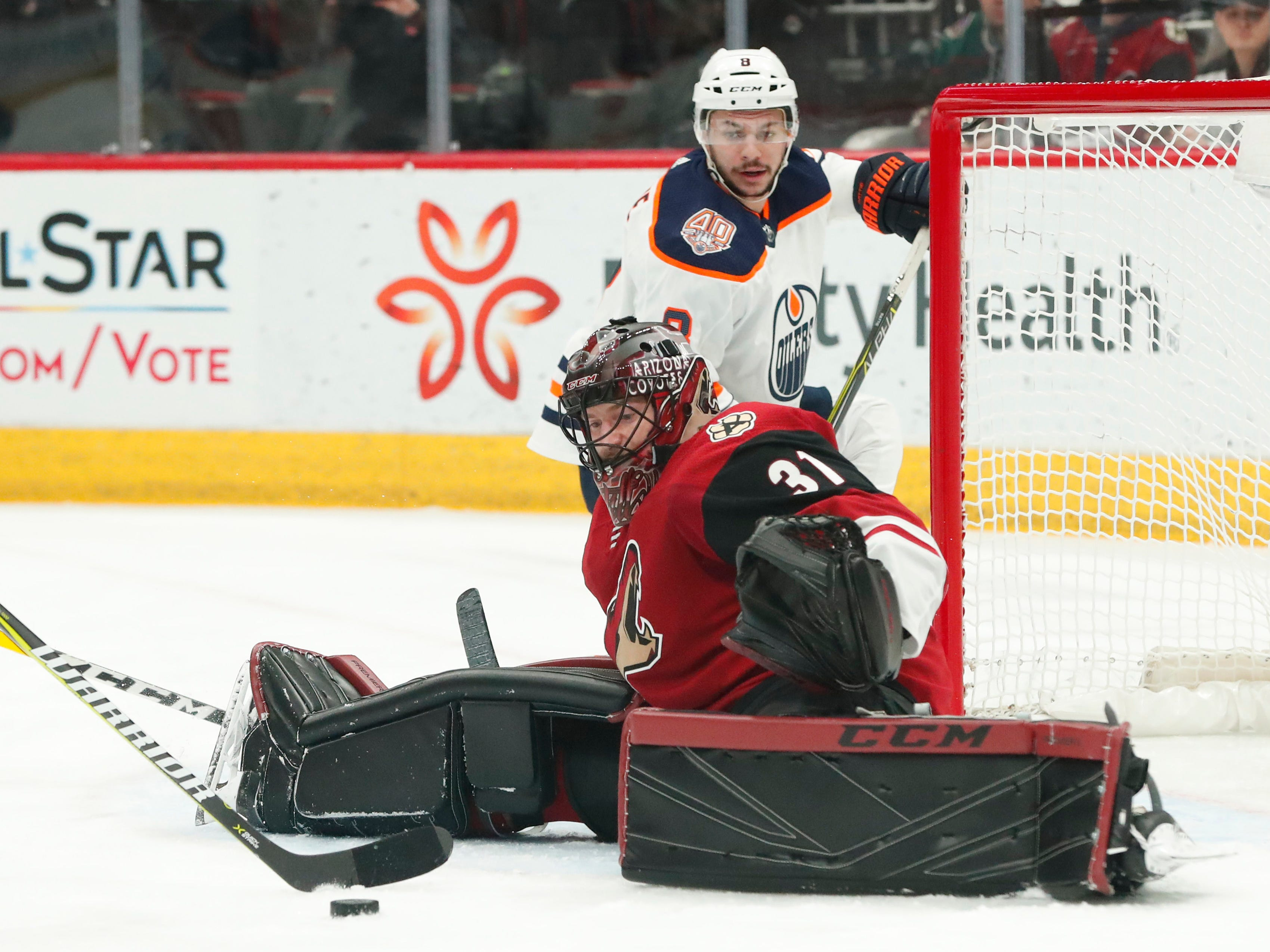 Arizona Coyotes goaltender Adin Hill (31) spreads out in front of Edmonton Oilers right wing Ty Rattie (8) during the first period in Glendale January 2, 2019.