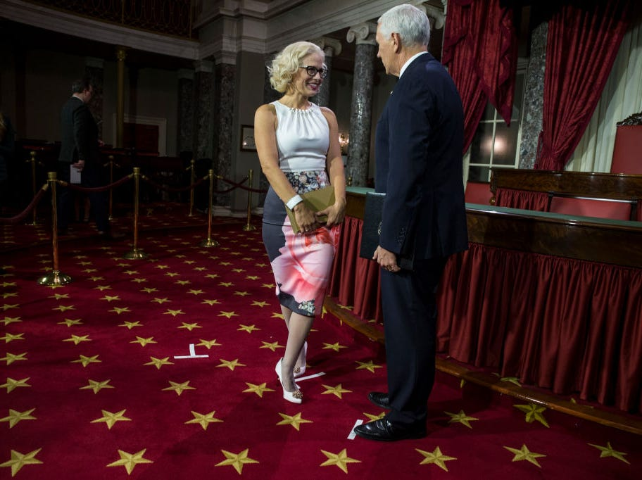 Sen. Kyrsten Sinema and Vice President Mike Pence talk during the swearing-in re-enactments for recently elected senators in the Old Senate Chamber on Capitol Hill in Washington, D.C., Jan. 3, 2019.